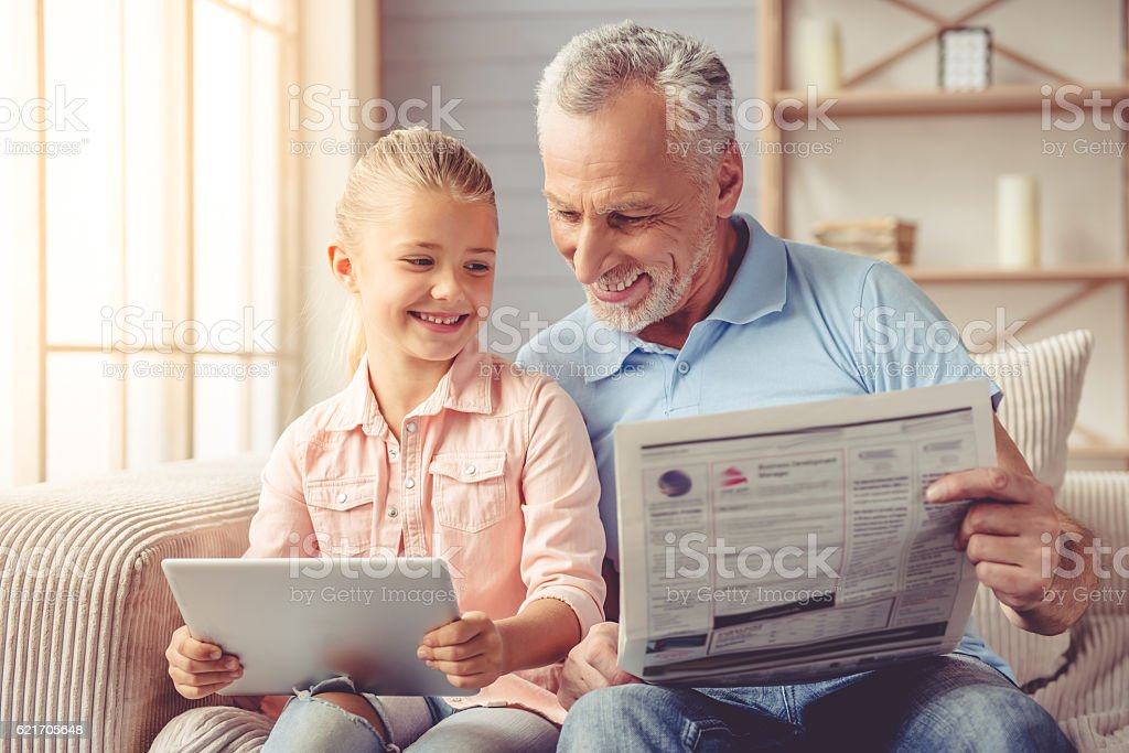Grandpa and little girl at home stock photo