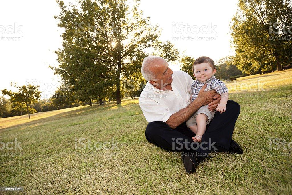 Grandpa and nephew at park stock photo