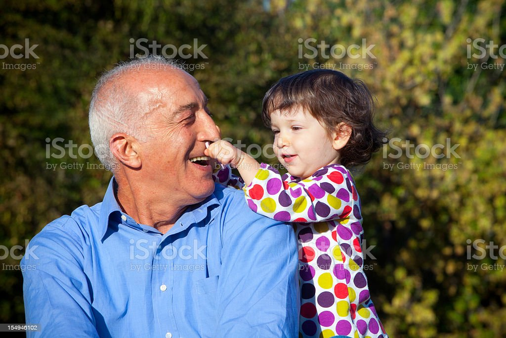 Grandpa and young niece royalty-free stock photo