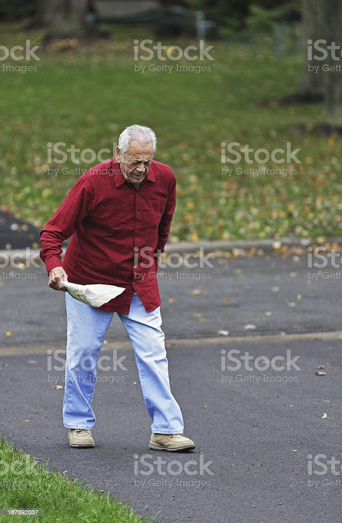Grandpa Getting The Morning Newspaper stock photo