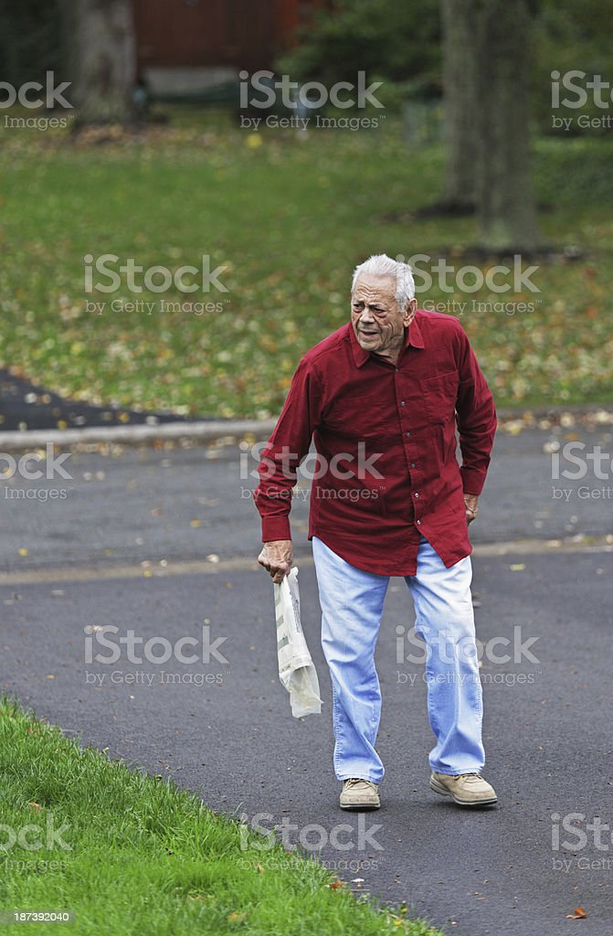 Grandpa Holding The Morning Newspaper stock photo