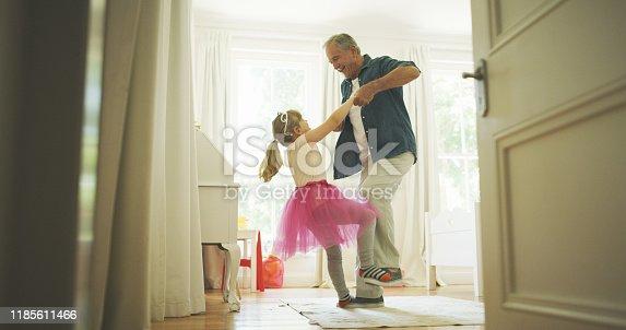 Shot of a senior man having fun with his granddaughter at home