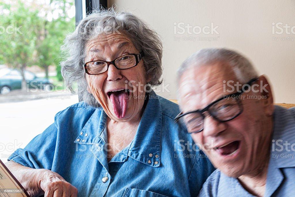 Grandpa Photo Bombing Grandma Making Funny Tongue Wagging Face - Photo