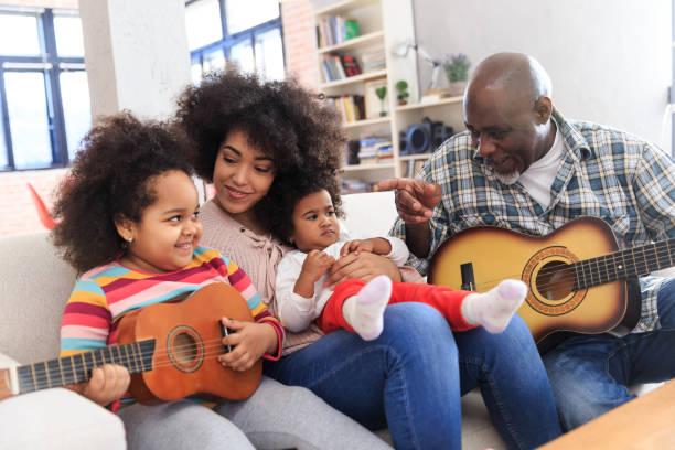 opa spielt gitarre - gitarren geburtstagstorten stock-fotos und bilder