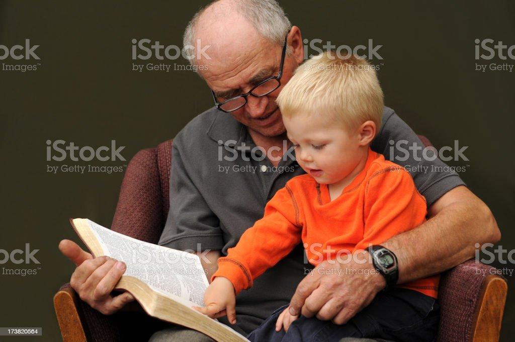 grandpa reading stock photo