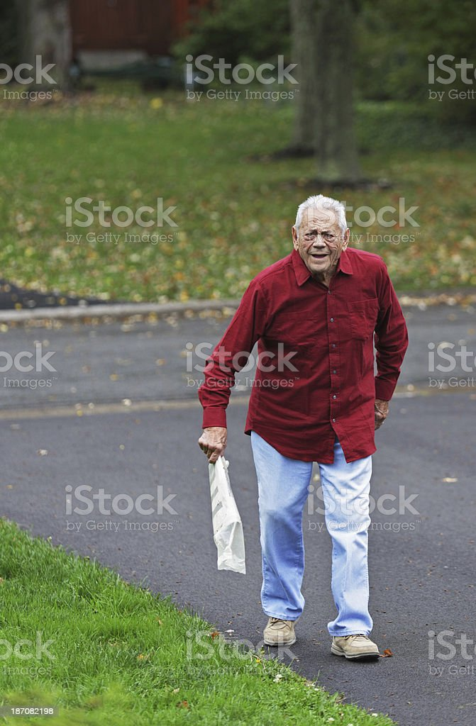 Grandpa With His Morning Newspaper stock photo
