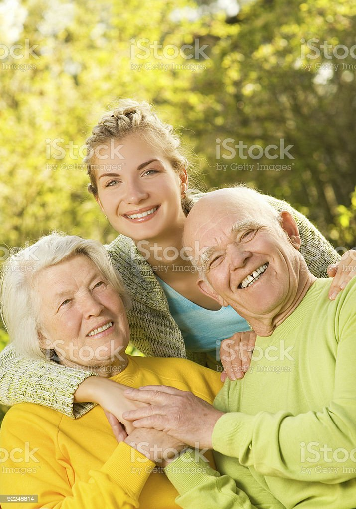 Grandparants with granddaughter outdoors royalty-free stock photo