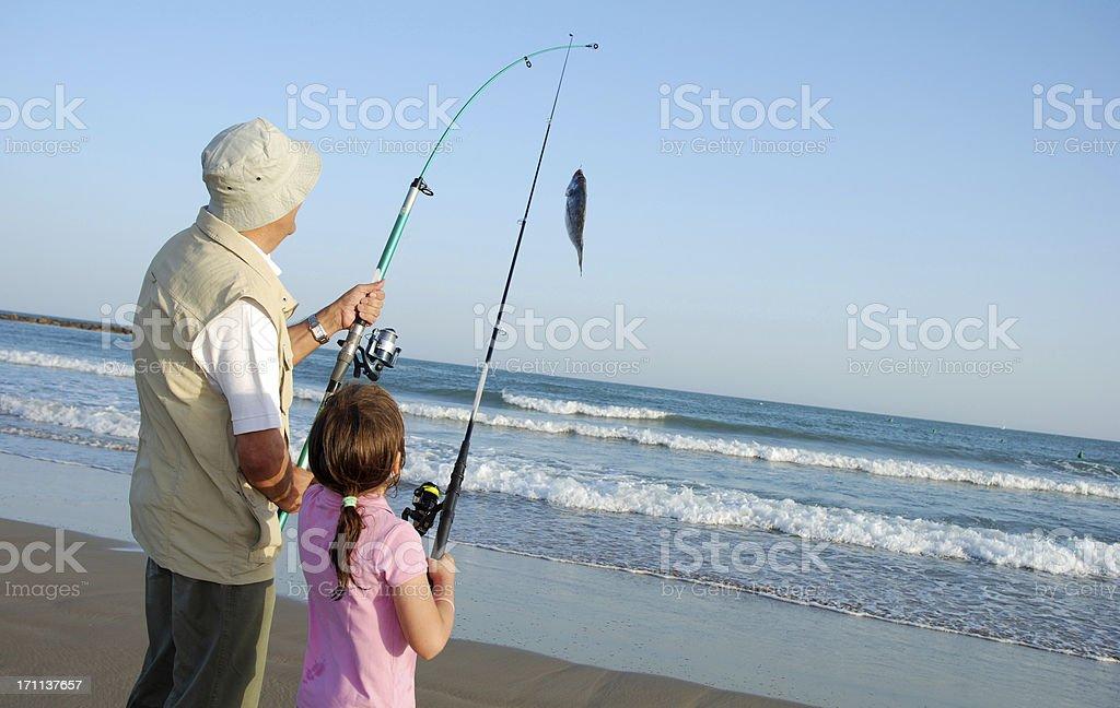 Grandparent and grandhild fishing stock photo