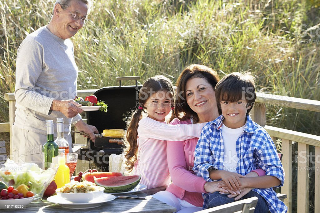 Grandparents And Grandchildren Having Outdoor Barbeque royalty-free stock photo