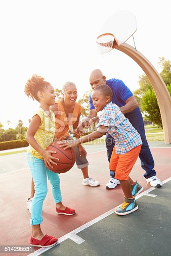 646011750 istock photo Grandparents And Grandchildren Playing Basketball Together 514295531