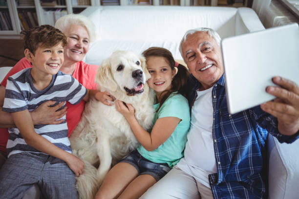 Grandparents and grandchildren taking  a selfie with digital tablet stock photo