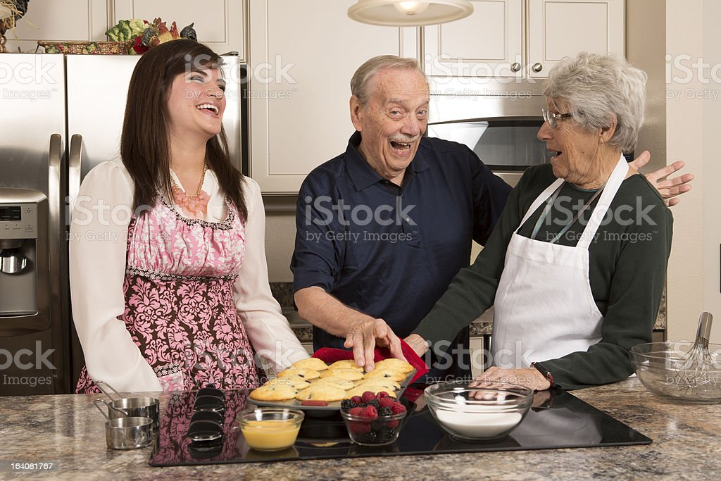 Grandparents and Granddaughter cooking in kitchen royalty-free stock photo