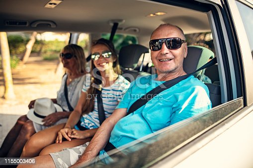 istock Grandparents and granddaughter during road trip 1155003406