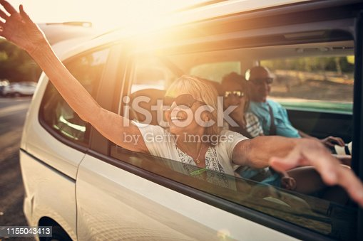 istock Grandparents and granddaughter during road trip 1155043413