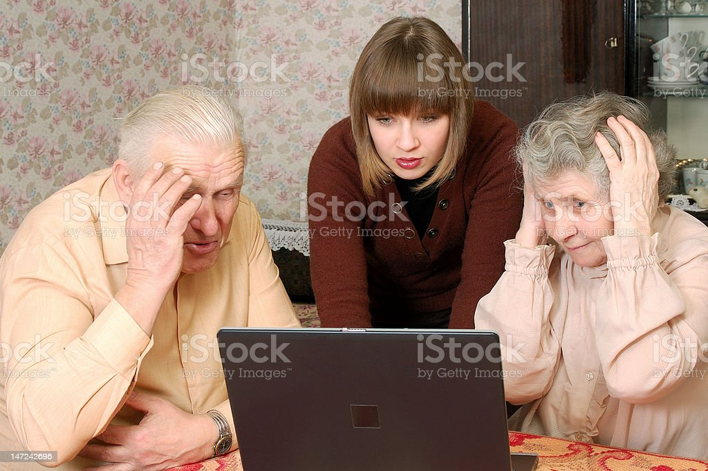 grandparents and granddaughter looking  in wide-eyed astonishmen royalty-free stock photo