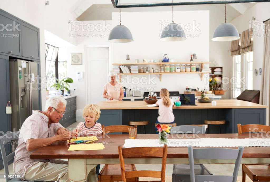 Grandparents And Grandkids Spending Time In Family Kitchen Royalty Free  Stock Photo