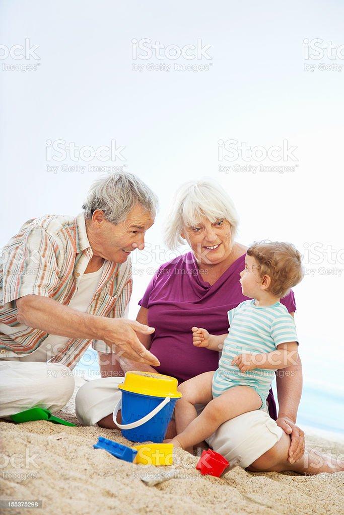Grandparents at the Beach having fun royalty-free stock photo