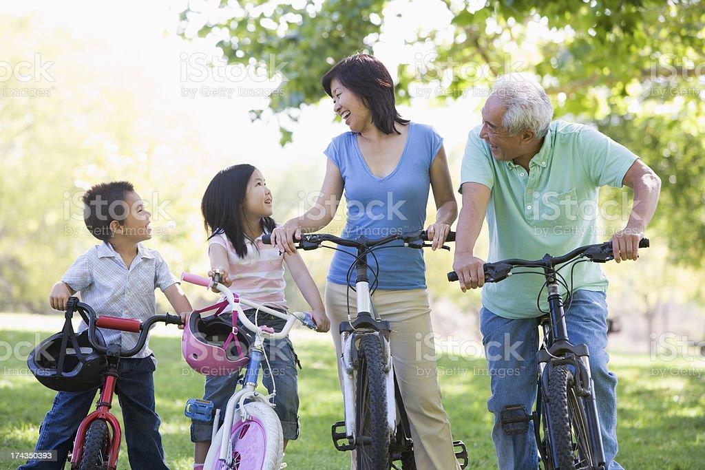 Grandparents bike riding with grandchildren stock photo