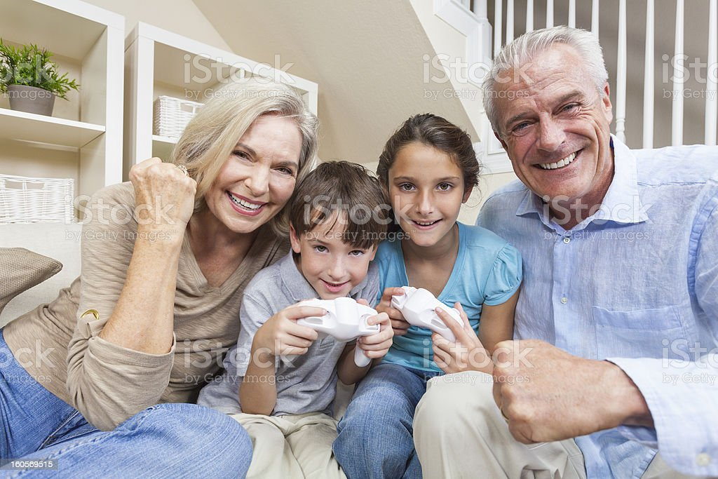 Grandparents & Children Family Playing Video Console Games royalty-free stock photo