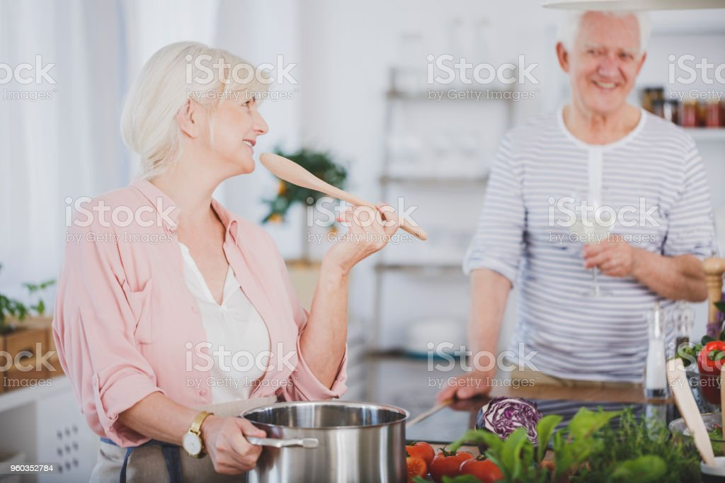 Grandparents cooking dinner stock photo
