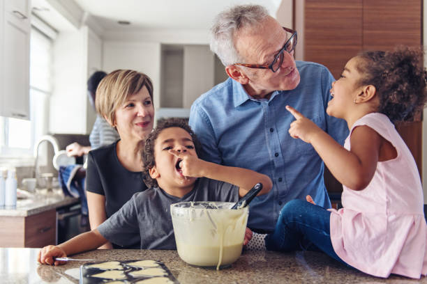 grandparents cooking with kids - kids cooking stock photos and pictures