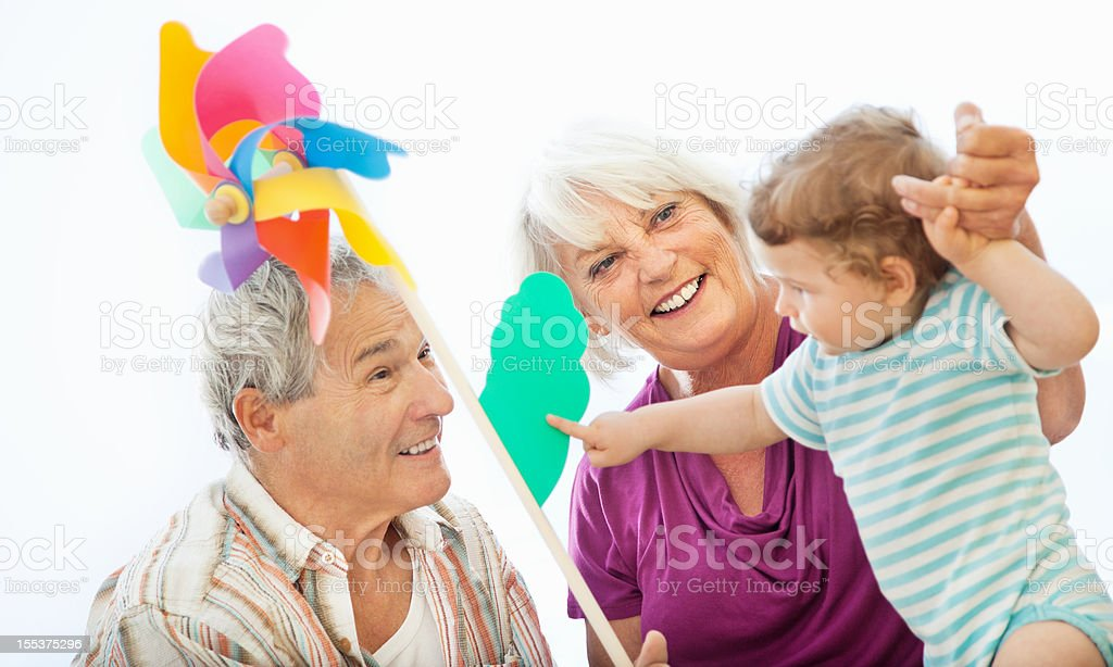 Grandparents having fun with their Grandchild royalty-free stock photo