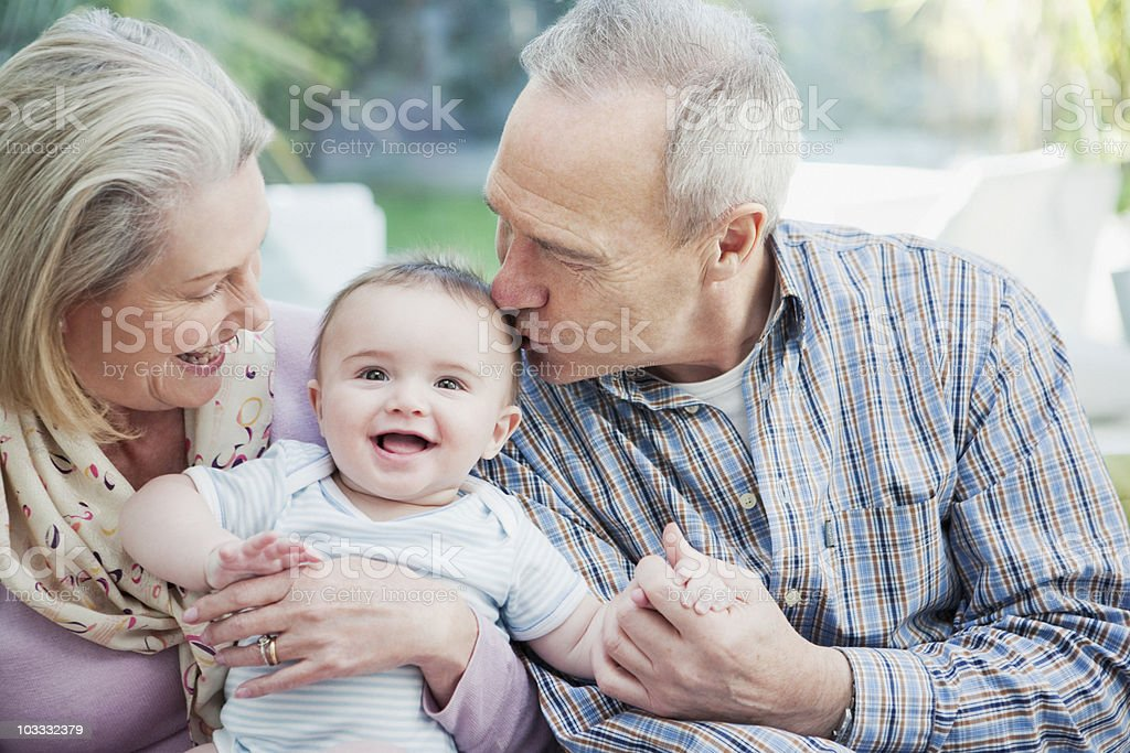 Grandparents holding baby grandson royalty-free stock photo