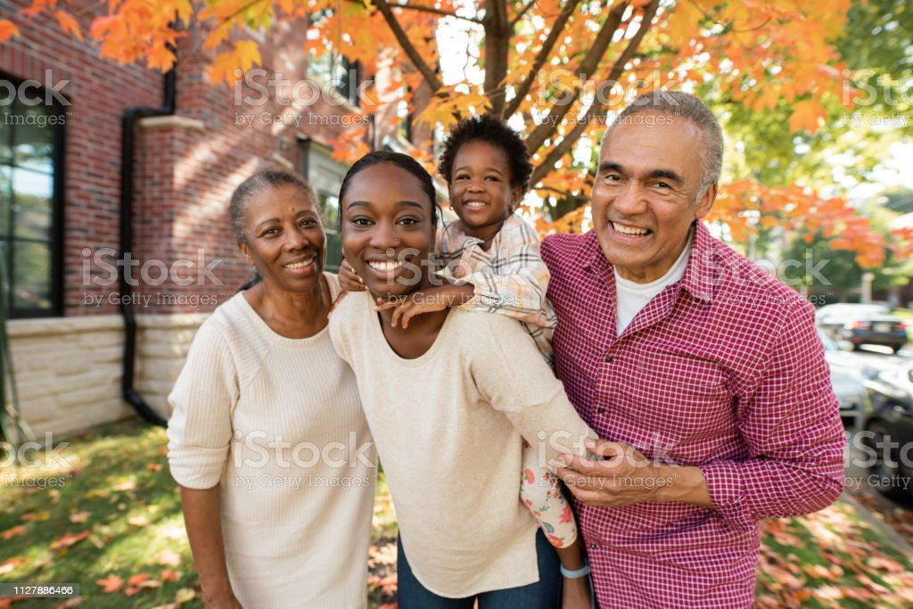 Grandparents, parent and granddaughter together stock photo