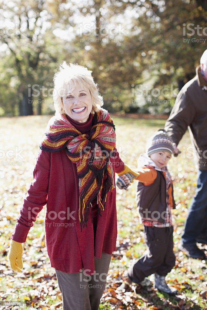 Grandparents playing in park with grandson 免版稅 stock photo