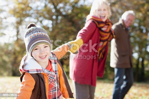 Grandparents Playing In Park With Grandson Stock Photo & More Pictures of 6-7 Years