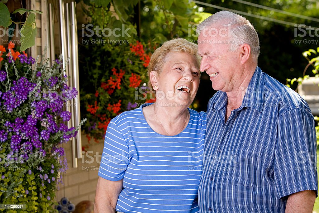 Grandparents share smiles and laughter outdoors royalty-free stock photo