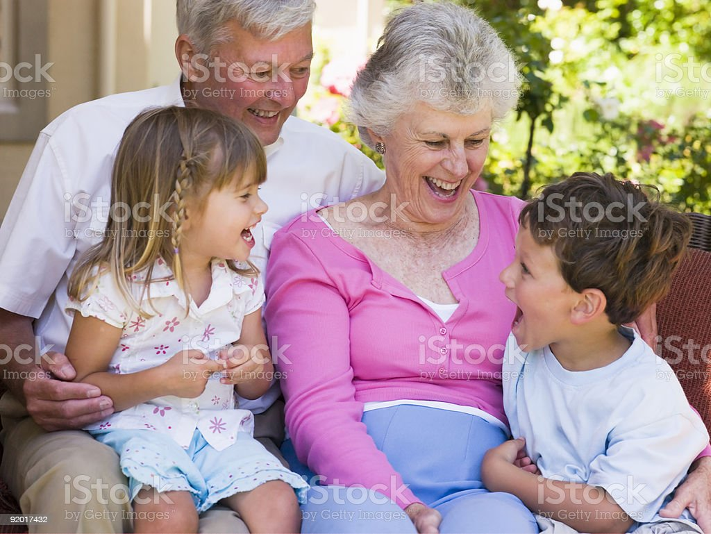 Grandparents spending time with their grandchildren royalty-free stock photo