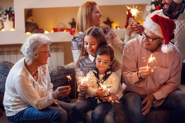 grandparents with children celebrating new year - christmas families stock photos and pictures