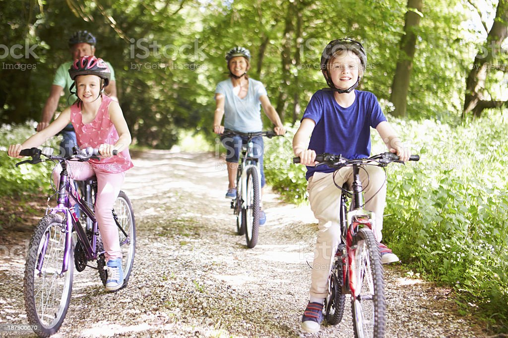 Grandparents With Grandchildren Cycling In Countryside royalty-free stock photo