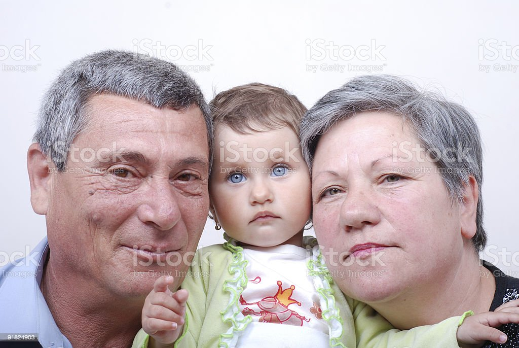 Grandparents with granddaughter royalty-free stock photo