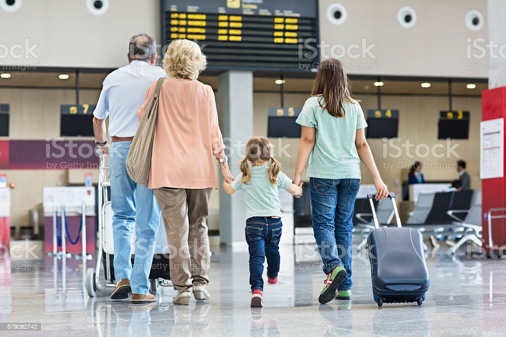 Grandparents with granddaughters travelling together on holidays stock photo