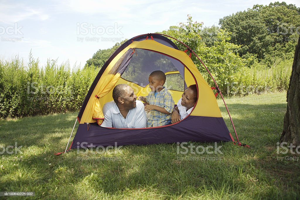Grandparents with grandson (4-5) in tent royalty free stockfoto
