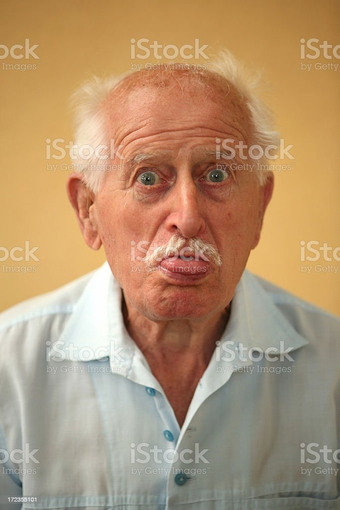 grandpa's tongue out royalty-free stock photo