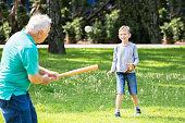 Grandson And Grandfather Playing Baseball