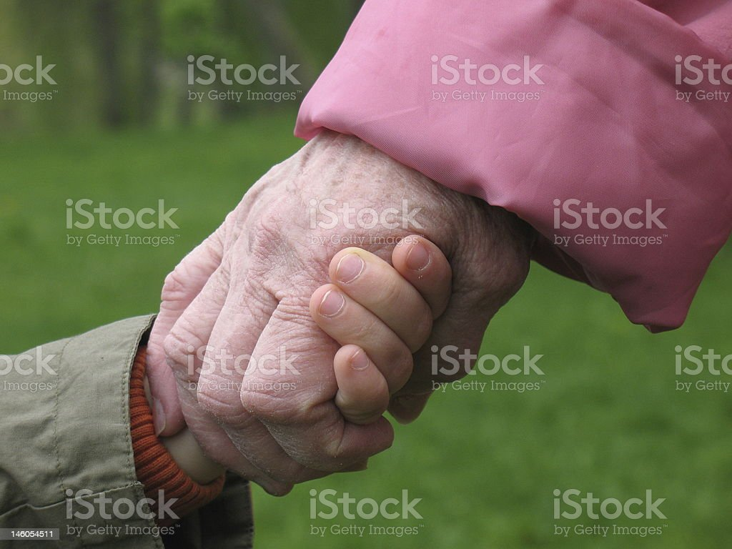 grandson and grandmother holding hands royalty-free stock photo