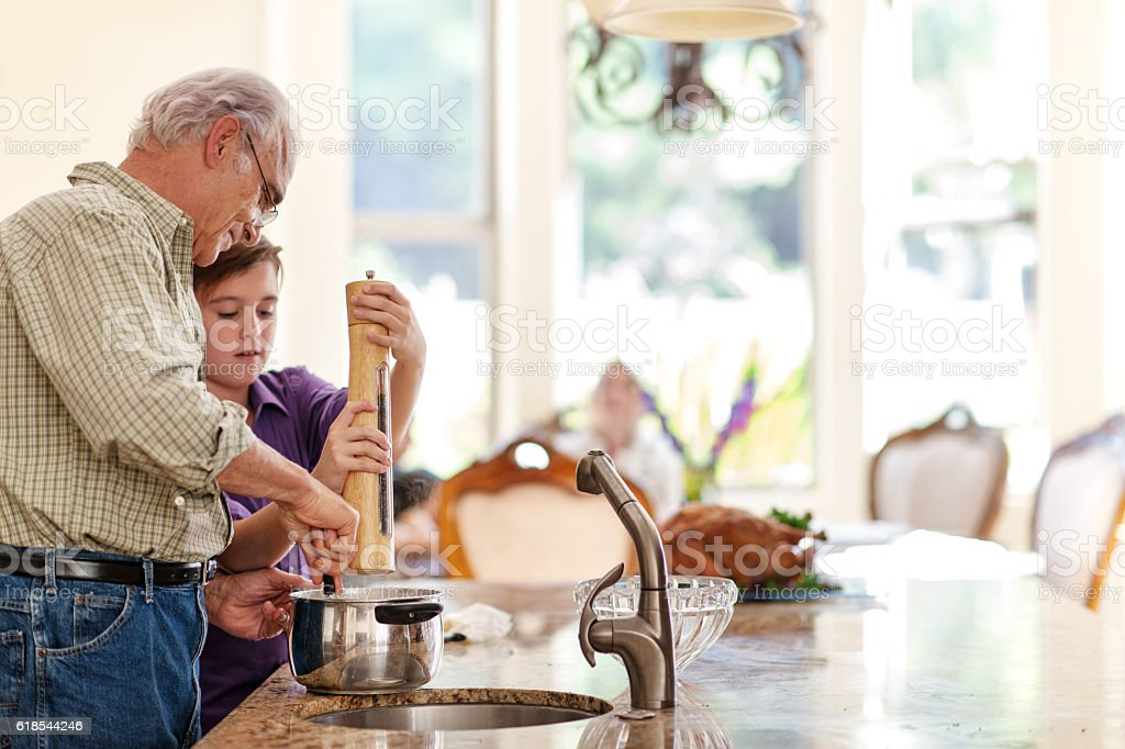 Grandson helping grandfather stock photo