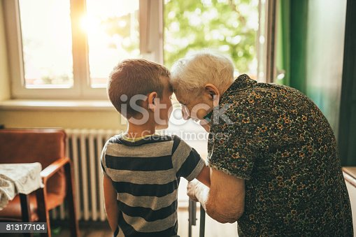 A photo of grandson spending time with his great-grand mother