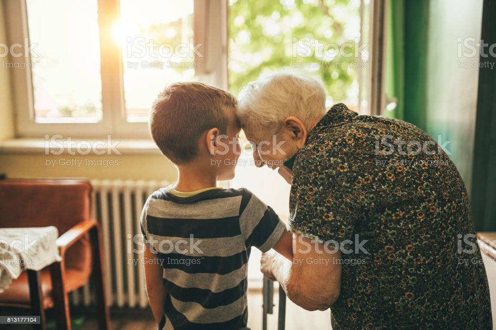 Grandson visiting his granny in nursery stock photo