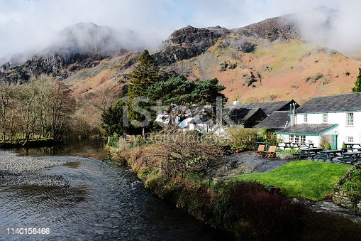 The picturesque village of Grange in the English Lake District with High Spy behind and the River Derwent adjacent