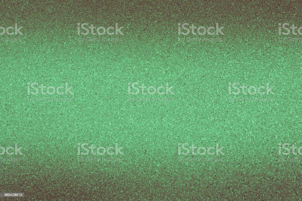 Granitowe tło w kolorze zielonym z małymi kropkami. Ciemnienie od góry i od dołu. - Zbiór zdjęć royalty-free (Architektura)
