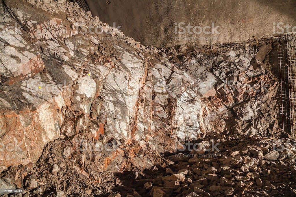 Granite bedrock on tunnel front stock photo