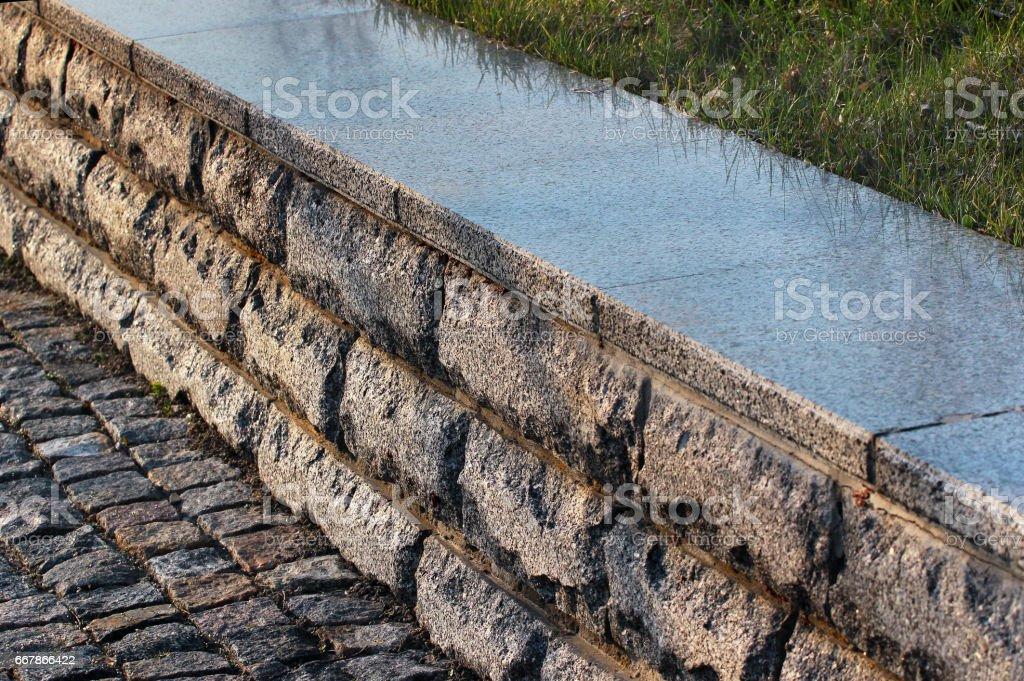 Granite border kerb in a park stock photo