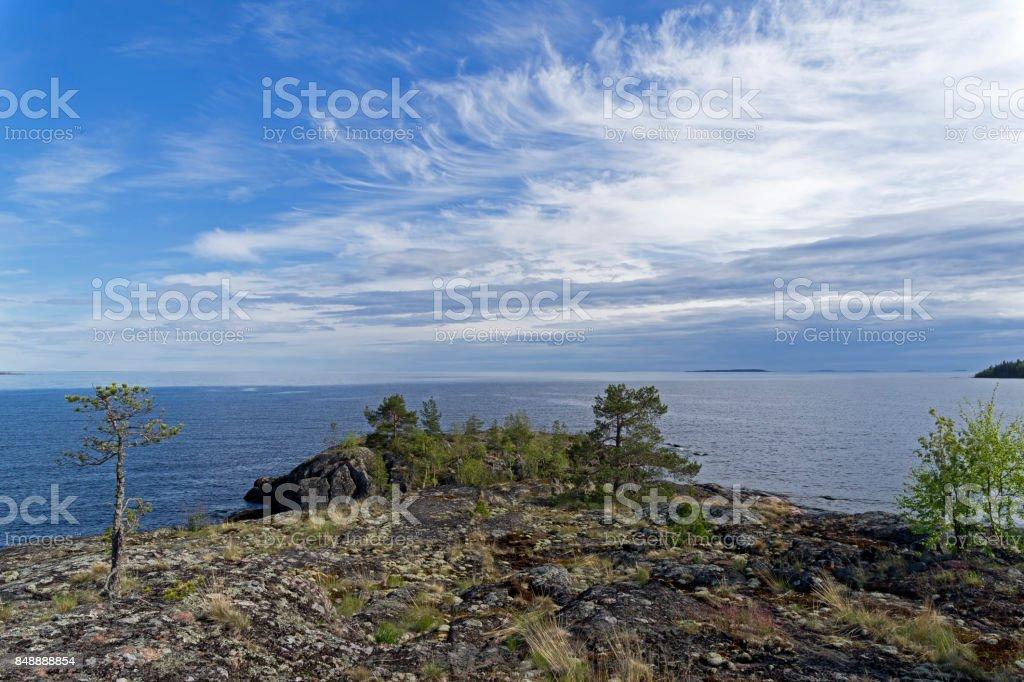 Granite cape on the shore of Lake Ladoga. stock photo