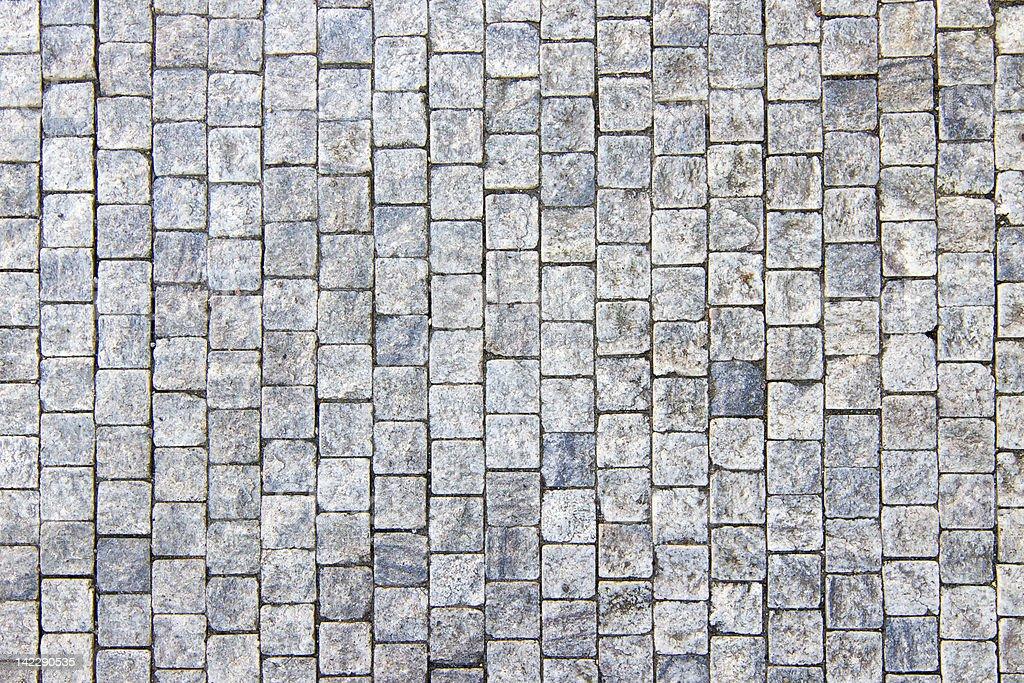 Granite cobblestoned pavement background stock photo