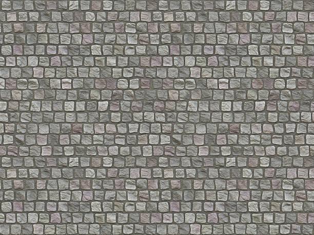 Granite cobblestoned pavement background. stock photo